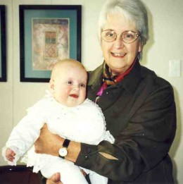 Esme Pollard holding Caitlin at the time of Caitlin's baptism in 2002