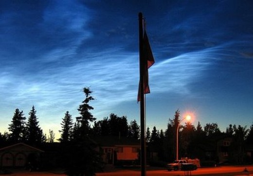 Just after sunset, or just before sunrise, you may see noctilucent or night shining clouds that are caused by solar radiation exciting hydrogen atom at the edge of space, typically at 80 to 100 kilometres up,