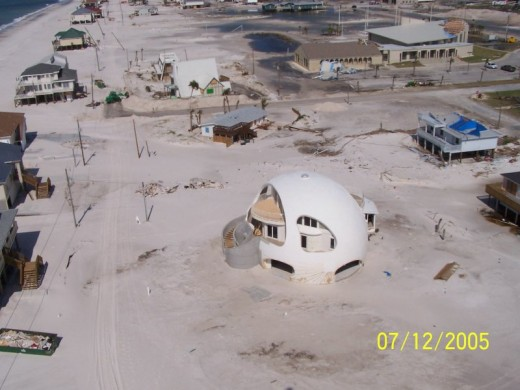 Pensacola beach sand after Hurricane Dennis finished shifting it around.  My in-laws used to have a beach house near the upper edge of this frame; Dennis took it.  Image courtesy Wikimedia Commons and NOAA.