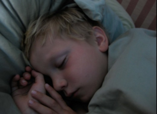 A child taking good night sleep after aromatherapy application.