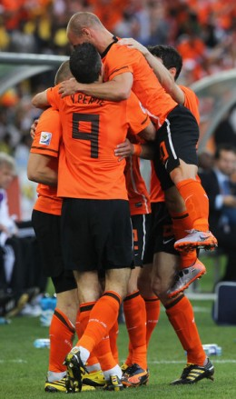 Wesley Sneijder and Robin Van Persie celebrate with Arjen Robben of the Netherlands as he scores the opening goal during the 2010 FIFA World Cup South Africa Round of Sixteen match between Netherlands and Slovakia at Durban Stadium on June 28, 2010 i