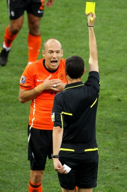 Arjen Robben of the Netherlands appeals to Referee Alberto Undiano as he receives a yellow card during the 2010 FIFA World Cup South Africa Round of Sixteen match between Netherlands and Slovakia at Durban Stadium on June 28, 2010 in Durban, South Af