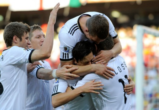 Miroslav Klose of Germany (R) celebrates scoring the opening goal with team mates during the 2010 FIFA World Cup South Africa Round of Sixteen match between Germany and England at Free State Stadium on June 27, 2010 in Bloemfontein, South Africa. (Ju