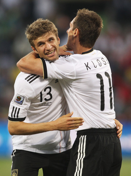 Thomas Mueller of Germany celebrates with teammate Miroslav Klose during the 2010 FIFA World Cup South Africa Round of Sixteen match between Germany and England at Free State Stadium on June 27, 2010 in Bloemfontein, South Africa. (June 26, 2010 - P