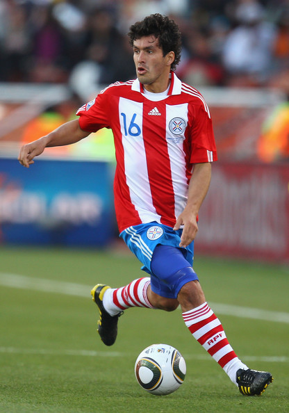 Cristian Riveros of Paraguay runs with the ball during the 2010 FIFA World Cup South Africa Group F match between Paraguay and New Zealand at Peter Mokaba Stadium on June 24, 2010 in Polokwane, South Africa. (June 23, 2010 - Photo by Cameron Spencer