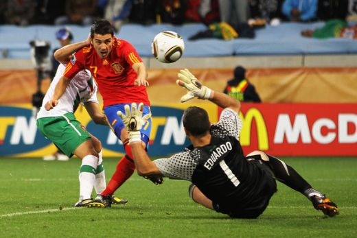 David Villa of Spain scores his side's first goal past Eduardo of Portugal during the 2010 FIFA World Cup South Africa South Africa. (June 28, 2010 - Photo by Doug Pensinger/Getty Images Europe)