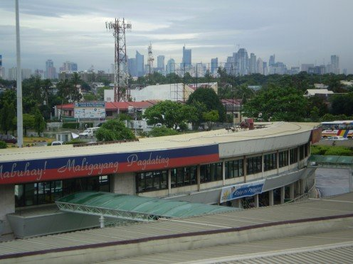 The Makati City skyline from Ninoy Aquino International Airport - Manila's gateway.