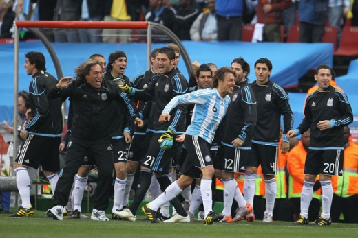 Gabriel Heinze of Argentina celebrates with teammates after he scores the opening goal during the 2010 FIFA World Cup South Africa Group B match between Argentina and Nigeria at Ellis Park Stadium on June 12, 2010 in Johannesburg, South Africa. (June