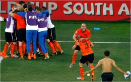 Members of the Netherlands team celebrated their 2-1 victory over Brazil on Friday. Photo - David Gray/Reuters