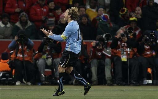 Uruguay's Diego Forlan celebrates after scoring a goal during the World Cup quarterfinal soccer match between Uruguay and Ghana at Soccer City in Johannesburg, South Africa, Friday, July 2, 2010