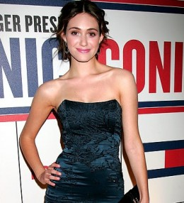 When asked about what makes Tommy Hilfiger and America so iconic, Emmy Rossum says, Tommy Hilfiger is America!