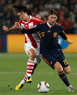 Paraguay's Nelson Haedo Valdez, left, vies for the ball with Spain's Sergio Ramos during the World Cup quarterfinal soccer match between Paraguay and Spain at Ellis Park Stadium in Johannesburg, South Africa, Saturday, July 3, 2010. (AP Photo/Bernat