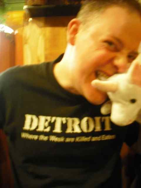 Could be performance art: My friend Mike bites a unicorn.