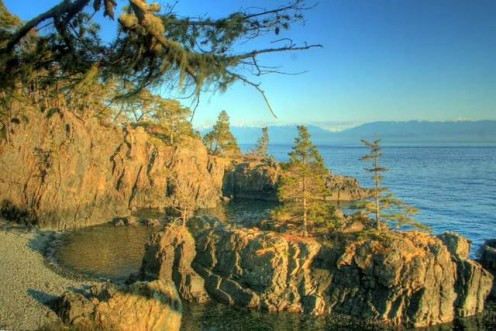 Hiking the 10 kilometer (6 mile) Coast Trail in East Sooke Park, BC.