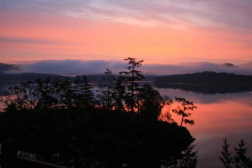 An early morning sunrise over the Sooke Basin, just outside of Victoria, BC on Vancouver Island.