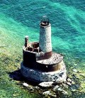 Aerial photo of the Waugoshance lighthouse marking the dangerous shoals in Lake Michigan off shore from Waugoshance Island in the Wilderness State Park