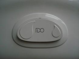Low flush toilet button.