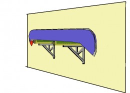 Screw eyebolts into the ends of the 2 by 4's. Set the canoes on top of the shelf.