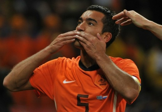 Netherlands' defender Giovanni van Bronckhorst celebrates after scoring a goal during the 2010 World Cup semi-final match between Uruguay and Netherlands on July 6, 2010 at Green Point Stadium in Cape Town  - ROBERTO SCHMIDT/AFP/Getty ImagesPhoto