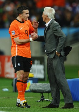 Bert van Marwijk head coach of the Netherlands talks with Robin Van Persie on the touchline during the 2010 FIFA World Cup South Africa Round of Sixteen match between Netherlands and Slovakia at Durban Stadium on June 28, 2010 in Durban, South Africa