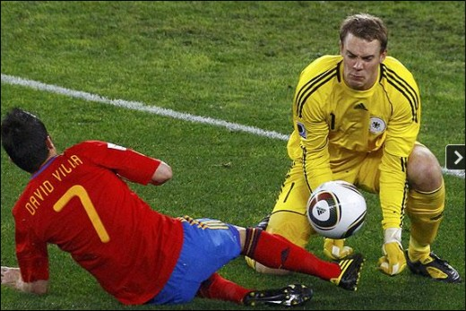 In for the kill: David Villa's chance is snuffed out by Manuel Neuer in world cup soccer semi finals v Germany Picture: REUTERS