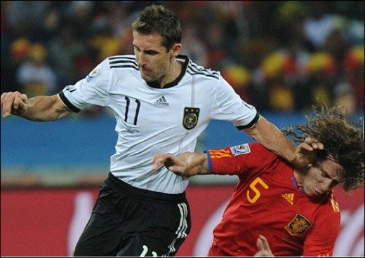 Spain v Germany Semi Finals in South Africa July 2010 Miroslav Klose sends Carles Puyol to the floor with his brute strengthPicture/ AFP