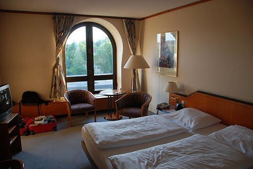 "As you can see, the Leonardo Hotel in Weimar has beautiful windows... which are usually marred by the world's most hideous curtains!  I... er... dismantled the bar and ""rearranged"" them."