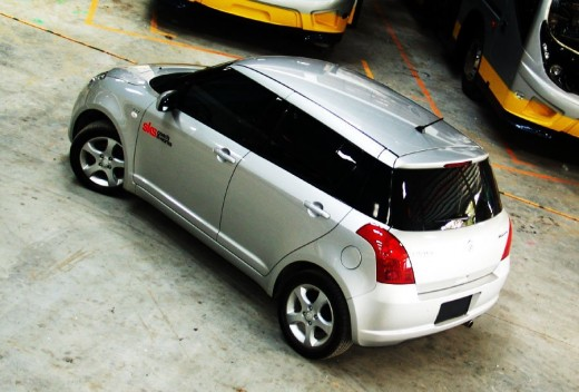 Maruti Swift Diesel Silver - backside view