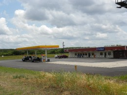 Shell Gas station with grocery and The National drive through bank