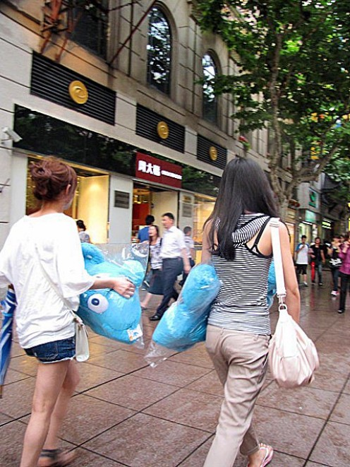 Shoppers carry World Expo souvenirs