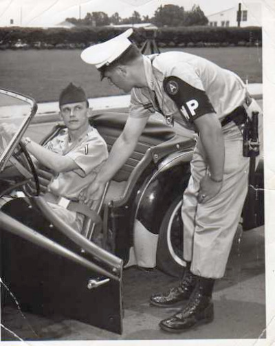 Me and my TR-3 in a 1967 seat-belt campaign ad at Fort McPherson in Atlanta