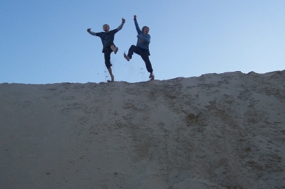 My boys jumping around on a sand dune at Igoda beach near East London, South Africa, in June 2010