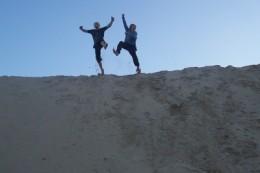 My boys jumping around on a sand dune at Igoda beach near East London, South Africa, in June 2010