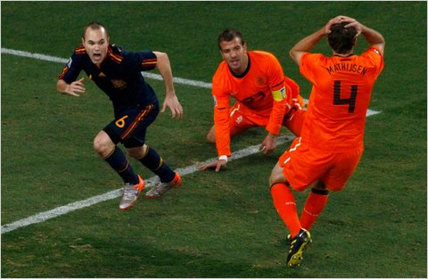 Andres Iniesta, left, celebrated after scoring Spains first and only goal on Sunday. Spain defeated the Netherlands, 1-0.  Photo - David Gray/Reuters