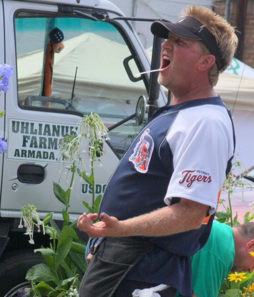 Organic food vendor sings along with John Martini