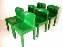 Green chairs designed by Carlo Bartoli for Kartell