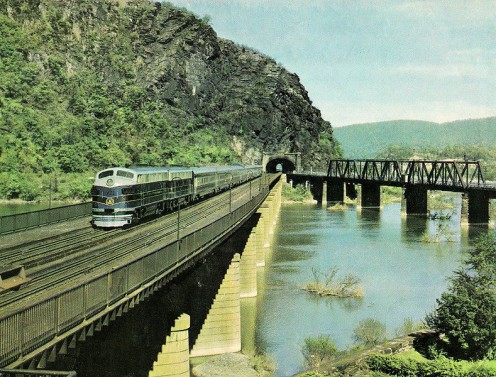 "The old B & O or Baltimore and Ohio Railroad operated the new ""Columbian"" passenger train at Harpers Ferry, WV in this postcard photo from 1949."