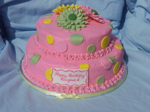 Gerbera Daisy on pink buttercream frosting