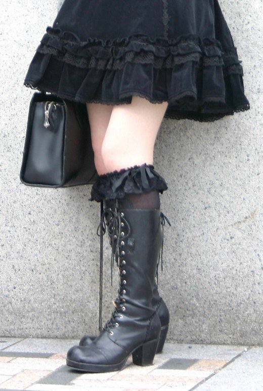 This is a another great example of a stunning outfit seen on the streets of Tokyo's fashionable Harajuku district. Black laceup boots are a classic gothic clothing staple. Here they are combined with lacy black knee length socks.