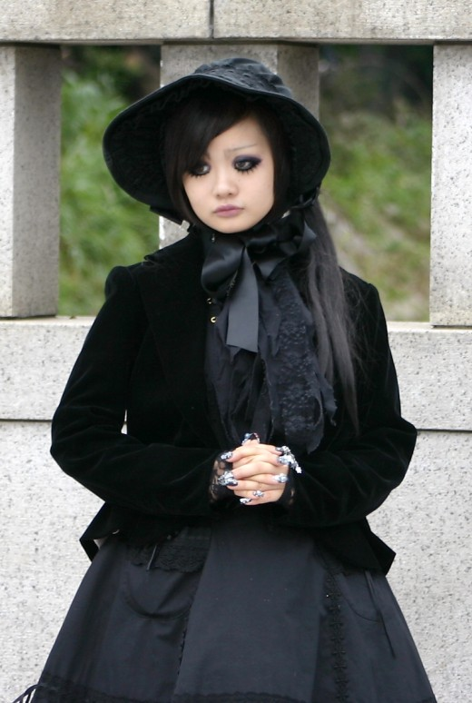 A stunningly beautiful outfit straight from Harajuku. Lots of lace, lots of black. This is a Victorian inspired black gothic lolita outfit. Notice the elaborate nails which are truly wonderous as well as the beautiful eye makeup.
