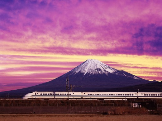Bullet train zooming by mount Fuji