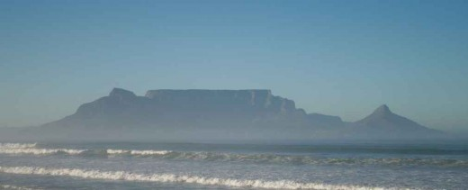 """We shall not forget our first sight of Africa in a hurry. The sun was rising and threw Table Mountain into a movement of shadow and colour. The rocks seemed to change shape as the light increased and the tablecloth of cloud slowly dispersed."" From B"
