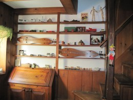A display of dulcimers & artwork.