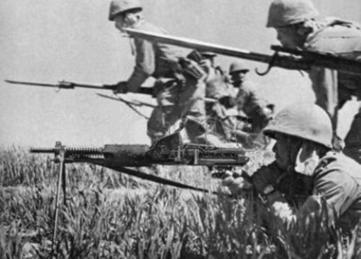 japanese army infantry in action during the invasion of the phillipines