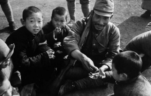 Japanese Military giving Candy to the Chinese children