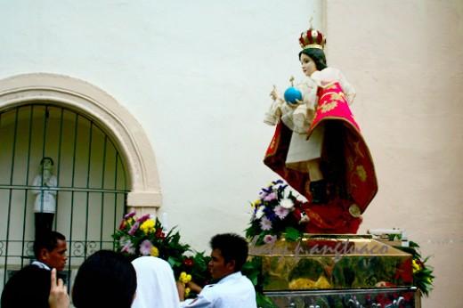 Santo Nino (Child Jesus) being prepared for the procession