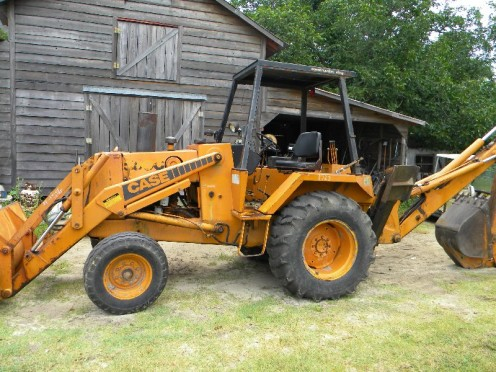 580C Case backhoe being repaired