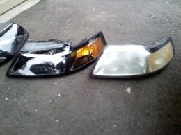 (new) OEM black housing headlight vs (used) OEM chrome housing headlight