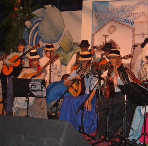 A band on stage at the Fiesta de la Virgen del Carmen