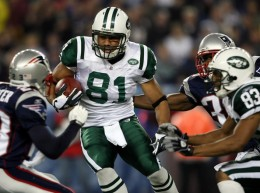 Dustin Keller #81 of the New York Jets weaves past Jason Webster Patriots on November 13, 2008 at Gillette Stadium in Foxboro, Massachusetts.